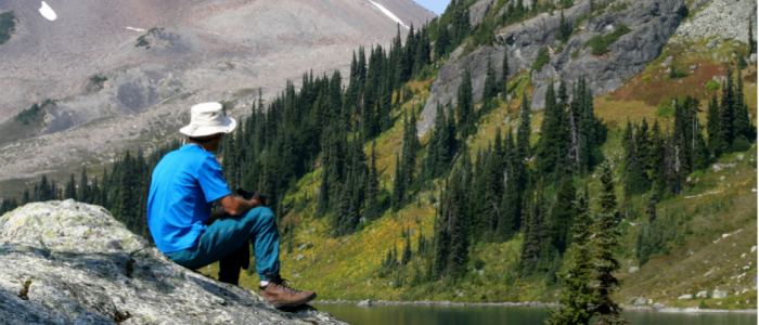Image of a hiker, lake and mountain