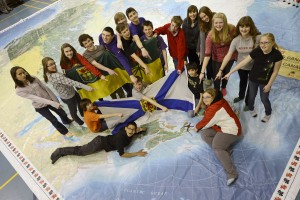 Students from Laurie Pylatuk's grade 8 Caronport Elementary School class pose for a photo on a giant map of Canada on Monday, April 8, 2013 in Caronport, Sask. Pylatuk's class won Canada's Coolest School Trip and will be off for a 5 day trip to Nova Scotia June 3-7, 2013. Canadian Press Images