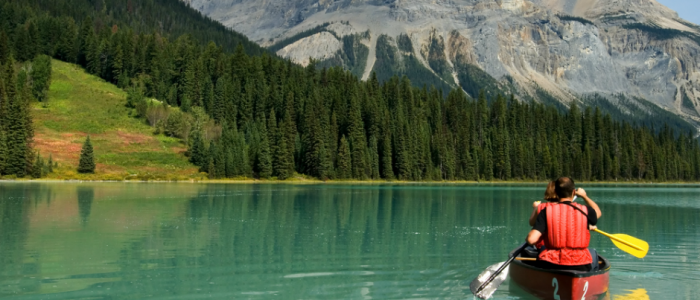 Image of people canoeing near mountains