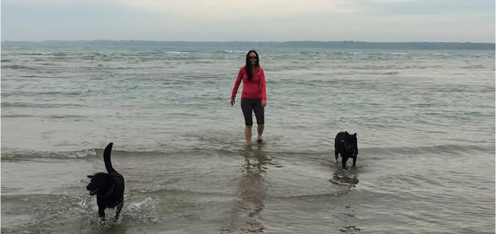Picutre of Pamela and her dogs in the water