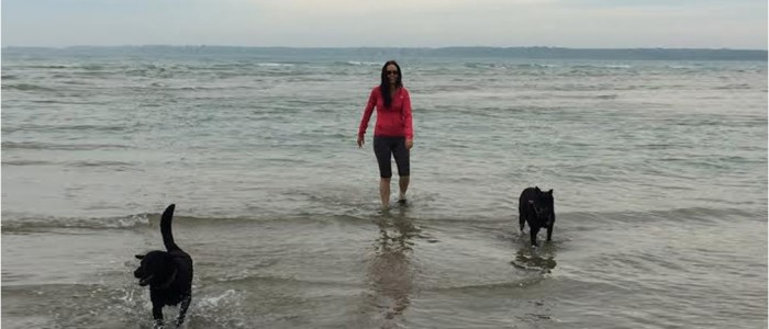 Picture of Pamela and her dogs in the water