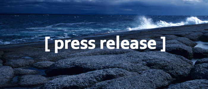 Image of a rocky coast with the text press release