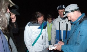 Referencing the field guild to identify a month on the Fall BioBlitz hike at Mud Lake.