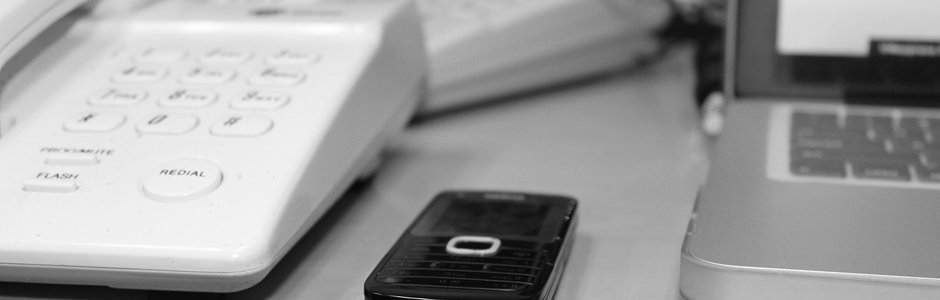 image of a cellphone and landline