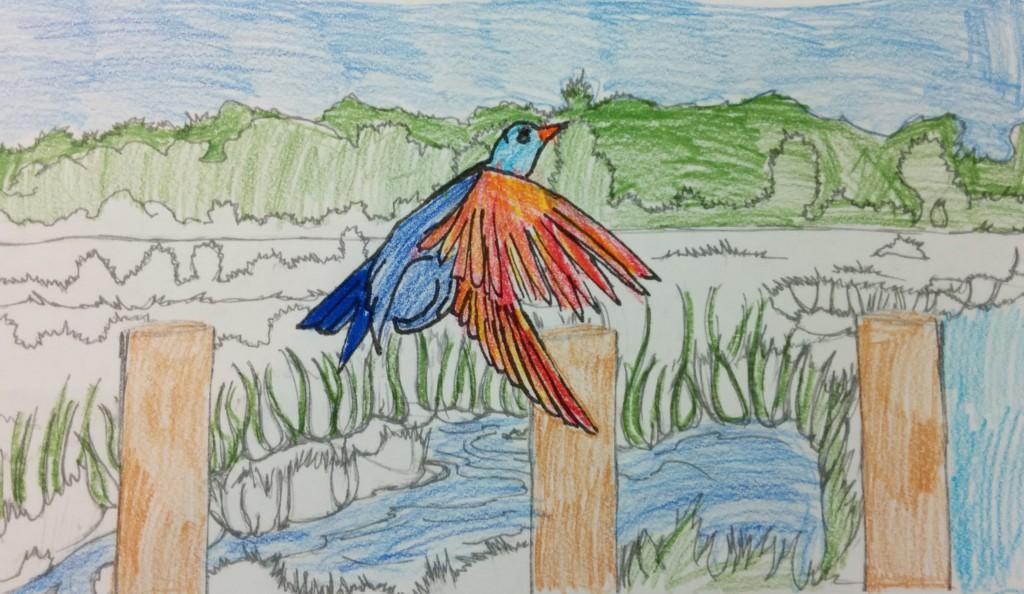 A bobolink in flight