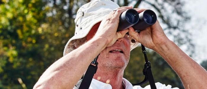Image of David Science looking through bonoculars