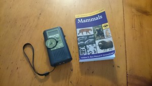 Magenta Bat5 handheld bat detector shown with Peterson's Guide to the Mammals of North America